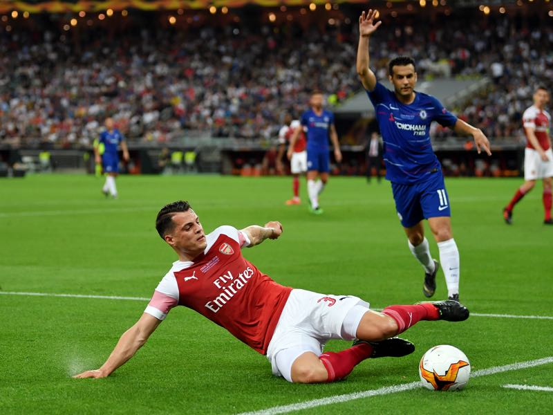 Granit Xhaka of Arsenal attempts to keep the ball in play during the UEFA Europa League Final between Chelsea and Arsenal at Baku Olimpiya Stadionu on May 29, 2019 in Baku, Azerbaijan. (Photo by Dan Mullan/Getty Images)