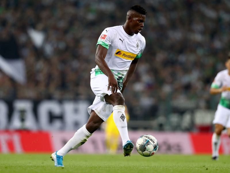 Breel Embolo of Moenchengladbach runs with the ball during the Bundesliga match between Borussia Moenchengladbach and RB Leipzig at Borussia-Park on August 30, 2019 in Moenchengladbach, Germany. (Photo by Lars Baron/Bongarts/Getty Images)