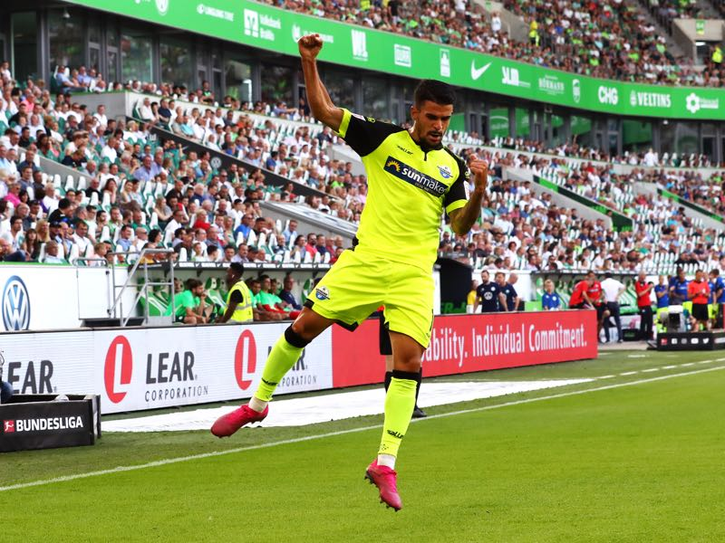 Cauly Oliveira Souza of SC Paderborn 07 celebrates after scoring his team's first goal during the Bundesliga match between VfL Wolfsburg and SC Paderborn 07 at Volkswagen Arena on August 31, 2019 in Wolfsburg, Germany. (Photo by Martin Rose/Bongarts/Getty Images)