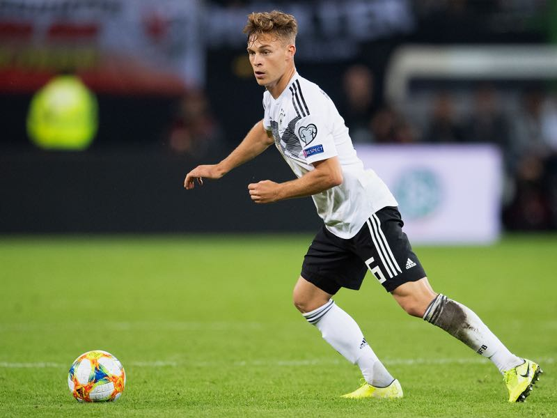 Joshua Kimmich of Germany controls the ball during the UEFA Euro 2020 qualifier match between Germany and Netherlands at Volksparkstadion on September 06, 2019 in Hamburg, Germany. (Photo by Matthias Hangst/Bongarts/Getty Images)