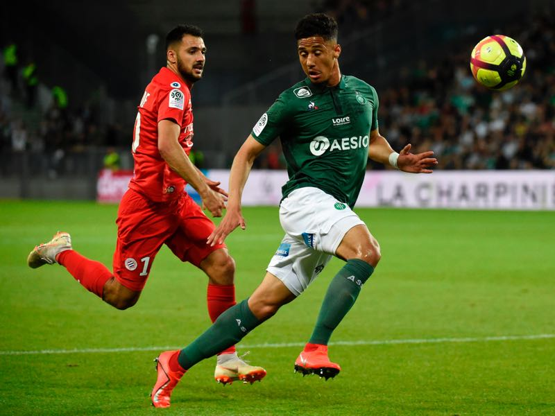 Montpellier's French forward Gaitan Laborde (L) vies with Saint-Etienne's French defender William Saliba (R) during the French L1 football match between Saint-Etienne (ASSE) and Montpellier (MHSC) on May 10, 2019, at the Geoffroy Guichard Stadium in Saint-Etienne, central France. (Photo by JEAN-PHILIPPE KSIAZEK / AFP)