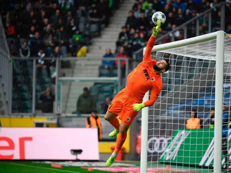 Augsburg's Czech goalkeeper Tomas Koubek jumps for the ball during the German first division Bundesliga football match Borussia Moenchengladbach vs FC Augsburg in Moenchengladbach, western Germany, on October 6, 2019. (Photo by Ina FASSBENDER / AFP)