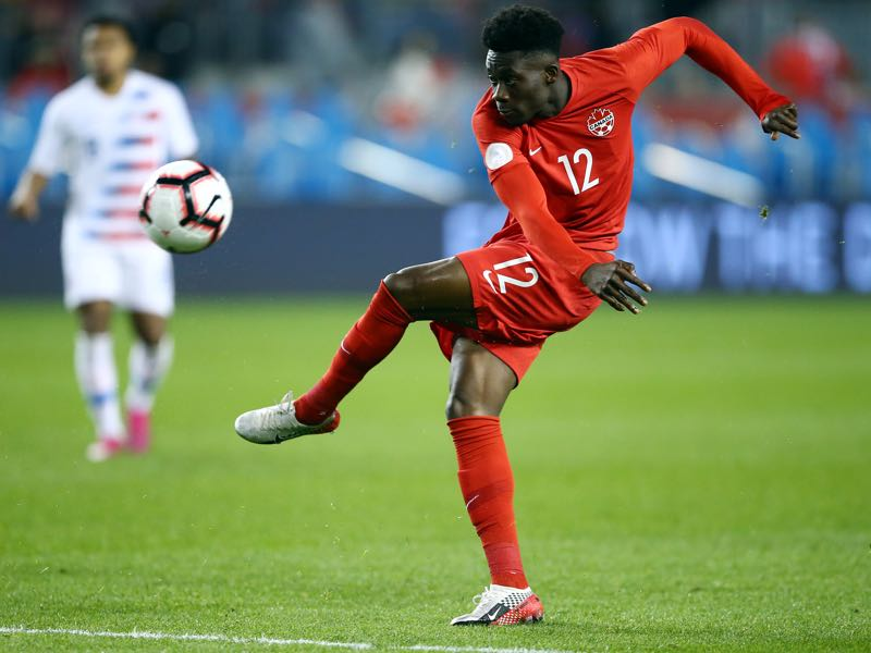 Canada v USA - Alphonso Davies #12 of Canada has a shot on goal during a CONCACAF Nations League game against the United States at BMO Field on October 15, 2019 in Toronto, Canada. (Photo by Vaughn Ridley/Getty Images)