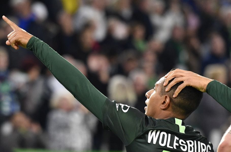 Wolfsburg's Brazilian forward Joao Victor (C) celebrates his goal, that was later disallowed, during the German First division Bundesliga football match between VfL Wolfsburg and FC Augsburg, on October 27, 2019 in Wolfsburg. - The goal was later disallowed. (Photo by John MACDOUGALL / AFP)