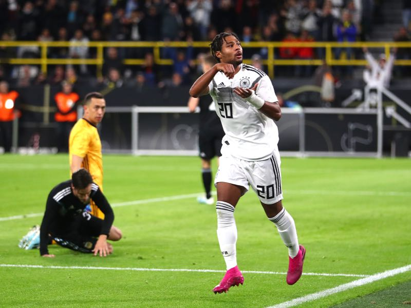 Germany v Argentina - Serge Gnabry of Germany celebrates after he scores his sides first goal under pressure from Jonas Hector of Germany during the International Friendly between Germany and Argentina at Signal Iduna Park on October 09, 2019 in Dortmund, Germany. (Photo by Dean Mouhtaropoulos/Bongarts/Getty Images)