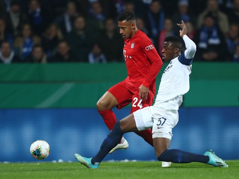 Bochum v Bayern Munich - Corentin Tolisso of FC Bayern Munich is challenged by Armel Bella-Kotchap of VfL Bochum during the DFB Cup second round match between VfL Bochum and Bayern Muenchen at Vonovia Ruhrstadion on October 29, 2019 in Bochum, Germany. (Photo by Lars Baron/Bongarts/Getty Images)