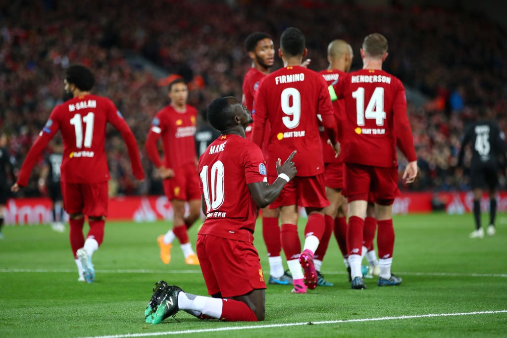 Sadio Mane of Liverpool celebrates after scoring his sides first goal during the UEFA Champions League group E match between Liverpool FC and RB Salzburg at Anfield on October 02, 2019 in Liverpool, United Kingdom. (Photo by Clive Brunskill/Getty Images)