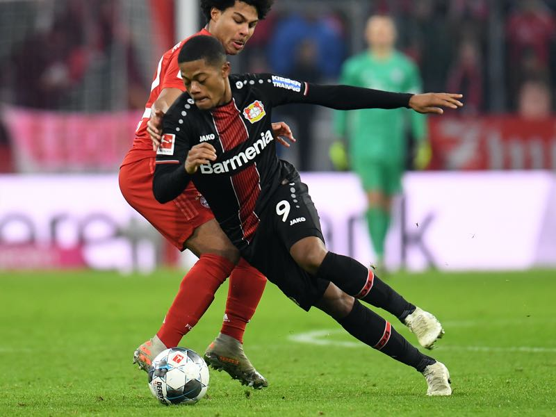 Bayern Munich v Leverkusen - Bayern Munich's midfielder Serge Gnabry (R) and Leverkusen's Brazil striker Leon Bailey (L) vie for the ball during the German first division Bundesliga football match FC Bayern Munich vs Bayer 04 Leverkusen in Munich, southern Germany, on November 30, 2019. (Photo by Christof STACHE / AFP)