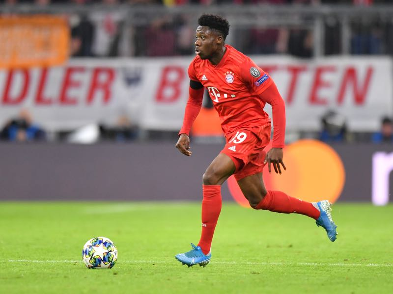 Alphonso Davies of Bayern Muenchen plays the ball during the UEFA Champions League group B match between Bayern Muenchen and Olympiacos FC at Allianz Arena on November 06, 2019 in Munich, Germany. (Photo by Sebastian Widmann/Bongarts/Getty Images )