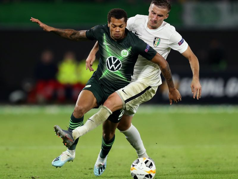 Lukas Nmecha of VfL Wolfsburg and Yevhen Banada of Oleksandriya clash during the UEFA Europa League group I match between VfL Wolfsburg and FC Oleksandriya at Volkswagen Arena on September 19, 2019 in Wolfsburg, Germany. (Photo by Maja Hitij/Bongarts/Getty Images )