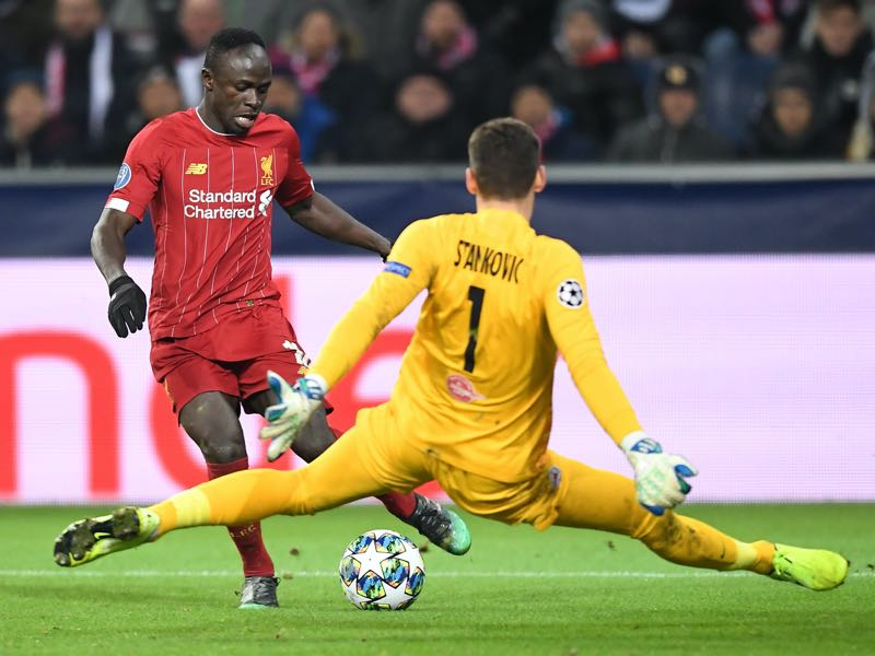 Salzburg v Liverpool - Liverpool's Senegalese striker Sadio Mane (L) and Salzburg's Austrian goalkeeper Cican Stankovic vie for the ball during the UEFA Champions League Group E football match between RB Salzburg and Liverpool FC on December 10, 2019 in Salzburg, Austria. (Photo by JOE KLAMAR / AFP) (Photo by JOE KLAMAR/AFP via Getty Images)