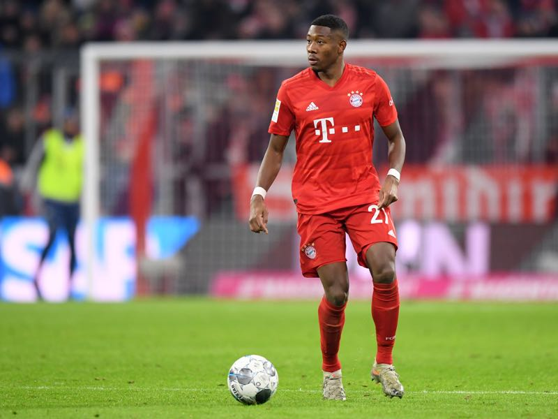 David Alaba of Bayern Muenchen plays the ball during the Bundesliga match between FC Bayern Muenchen and Bayer 04 Leverkusen at Allianz Arena on November 30, 2019 in Munich, Germany. (Photo by Sebastian Widmann/Bongarts/Getty Images)