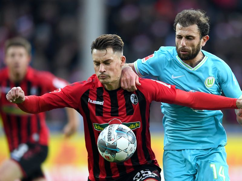 Robin Koch of Sport-Club Freiburg is challenged by Admir Mehmedi of VfL Wolfsburg during the Bundesliga match between Sport-Club Freiburg and VfL Wolfsburg at Schwarzwald-Stadion on December 07, 2019 in Freiburg im Breisgau, Germany. (Photo by Daniel Kopatsch/Bongarts/Getty Images)