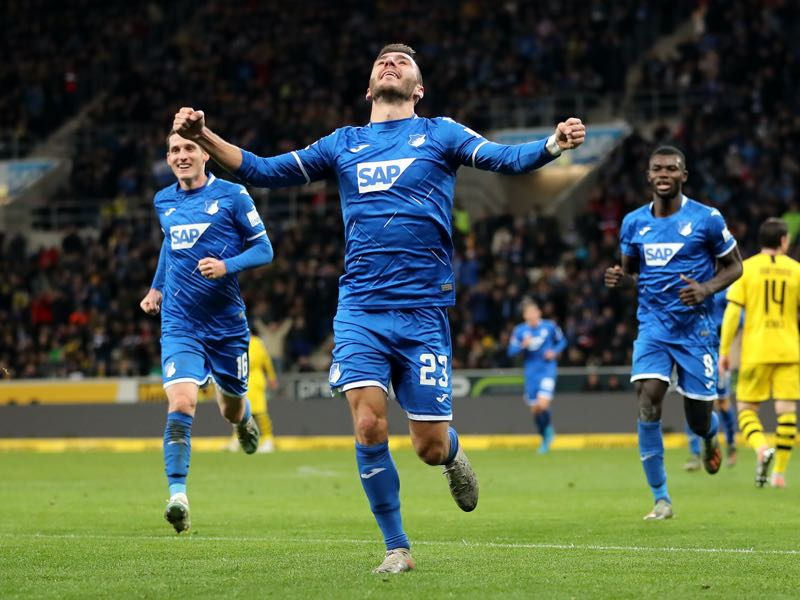 Hoffenheim v Dortmund -Sargis Adamyan of TSG 1899 Hoffenheim celebrates scoring the first Hoffenheim goal with team mates during the Bundesliga match between TSG 1899 Hoffenheim and Borussia Dortmund at PreZero-Arena on December 20, 2019 in Sinsheim, Germany. (Photo by Christian Kaspar-Bartke/Bongarts/Getty Images)
