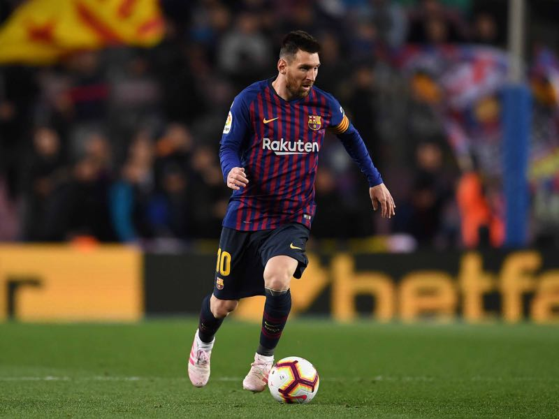Lionel Messi of FC Barcelona runs with the ball during the La Liga match between FC Barcelona and Real Sociedad at Camp Nou on April 20, 2019 in Barcelona, Spain. (Photo by David Ramos/Getty Images)