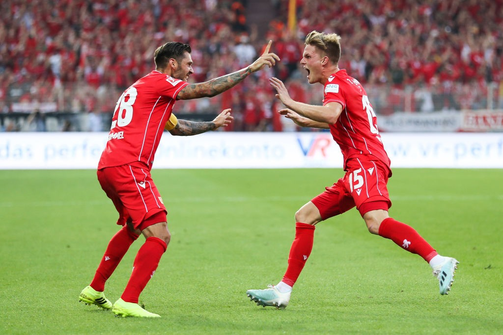 Marius Bulter (R) celebrates with his team mate Christopher Trimmel of FC Union Berlin after scoring his team's first goal during the Bundesliga match between 1. FC Union Berlin and Borussia Dortmund at Stadion An der Alten Foersterei on August 31, 2019 in Berlin, Germany. (Photo by Maja Hitij/Bongarts/Getty Images)