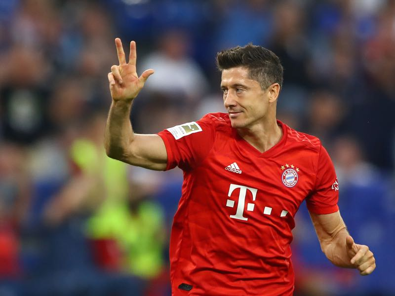 Schalke v Bayern Munich -Bayern Munich's Polish forward Robert Lewandowski celebrate scoring his third goal wiht his teammates during the German first division Bundesliga football match FC Schalke 04 FC Bayern Munich in Gelsenkirchen, western Germany on August 24, 2019. (Photo by UWE KRAFT / AFP)