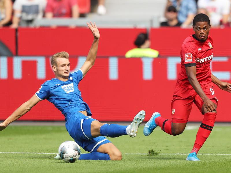 Bayer Leverkusen v Hoffenheim - Leon Bailey of Bayer 04 Leverkusen shoots past Stefan Posch of TSG 1899 Hoffenheim during the Bundesliga match between Bayer 04 Leverkusen and TSG 1899 Hoffenheim at BayArena on August 31, 2019 in Leverkusen, Germany. (Photo by Christof Koepsel/Bongarts/Getty Images)