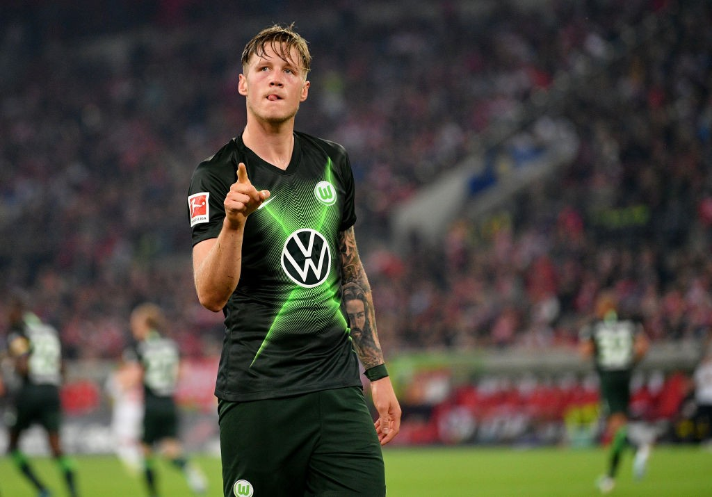 Wout Weghorst of VfL Wolfsburg celebrates after he scores his teams opening goal during the Bundesliga match between Fortuna Duesseldorf and VfL Wolfsburg