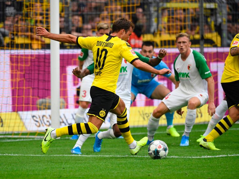 Dortmund's German midfielder Mario Götze runs in to the Augsburg box during the German first division Bundesliga football match BVB Borussia Dortmund v Augsburg in Dortmund, western Germany on August 17, 2019. (Photo by Ina FASSBENDER / AFP)