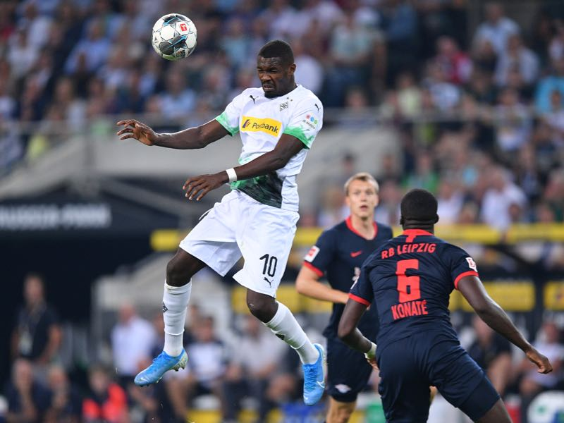 Marcus Thuram of Borussia Monchengladbach heads the ball past Ibrahima Konate of RB Leipzig during the Bundesliga match between Borussia Moenchengladbach and RB Leipzig at Borussia-Park on August 30, 2019 in Moenchengladbach, Germany. (Photo by Lukas Schulze/Bongarts/Getty Images)