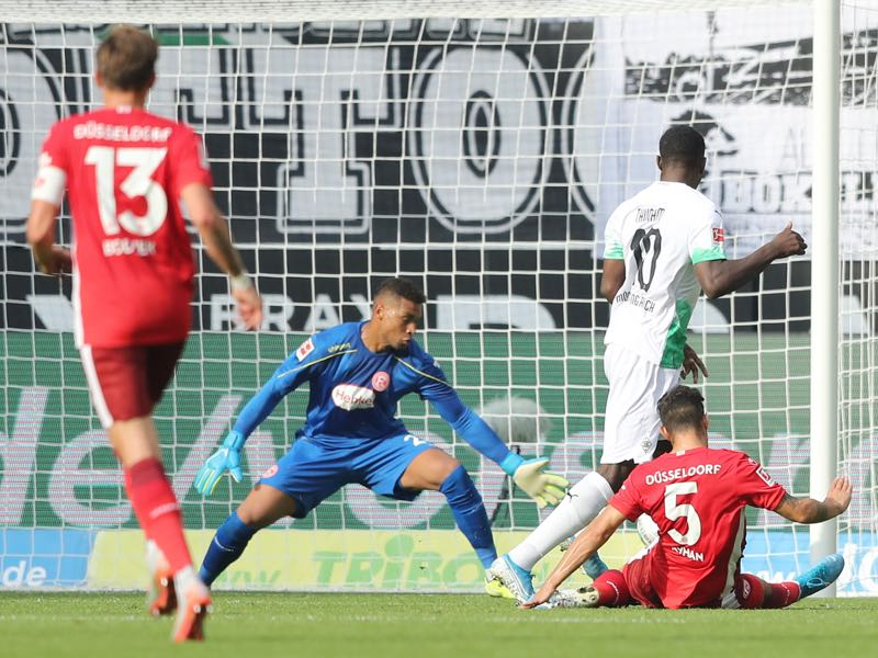 Gladbach v Fortuna Düsseldorf - Marcus Thuram of Moenchengladbach (2nd R) scores the first goal during the Bundesliga match between Borussia Moenchengladbach and Fortuna Duesseldorf at Borussia-Park on September 22, 2019 in Moenchengladbach, Germany. (Photo by Christof Koepsel/Bongarts/Getty Images)