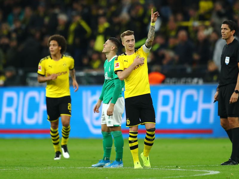 Dortmund v Bremen -Marco Reus of Borussia Dortmund celebrates scoring his teams second goal of the game during the Bundesliga match between Borussia Dortmund and SV Werder Bremen at Signal Iduna Park on September 28, 2019 in Dortmund, Germany. (Photo by Lars Baron/Bongarts/Getty Images)