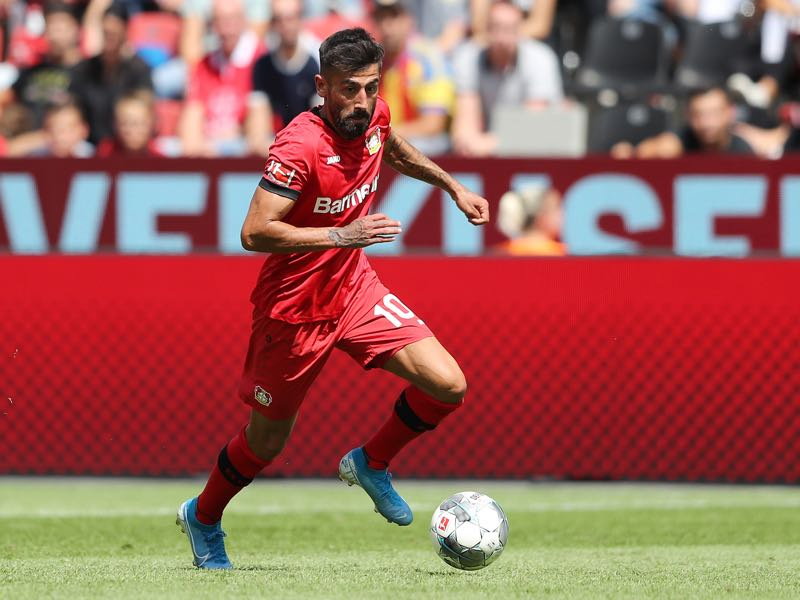 Kerem Demirbay of Leverkusen runs with the ball during the pre-season friendly match between Bayer 04 Leverkusen and FC Valencia at BayArena on August 04, 2019 in Leverkusen, Germany. (Photo by Christof Koepsel/Bongarts/Getty Images)