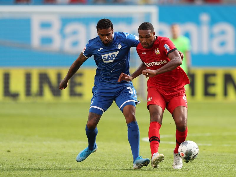 Jurgen Locadia of TSG 1899 Hoffenheim is challenged by Jonathan Tah of Bayer 04 Leverkusen during the Bundesliga match between Bayer 04 Leverkusen and TSG 1899 Hoffenheim at BayArena on August 31, 2019 in Leverkusen, Germany. (Photo by Christof Koepsel/Bongarts/Getty Images)