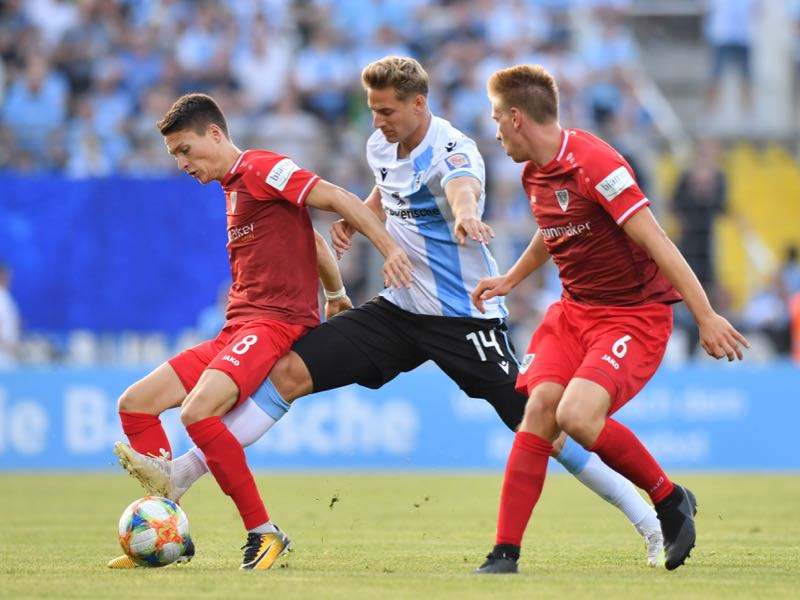 Dennis Dressel of TSV 1860 Muenchen challenges Maurice Litka of Preussen Muenster for the ball during the 3. Liga match between TSV 1860 Muenchen and Preussen Muenster at Stadion an der Gruenwalder Straße on July 19, 2019 in Munich, Germany. (Photo by Sebastian Widmann/Getty Images for DFB)