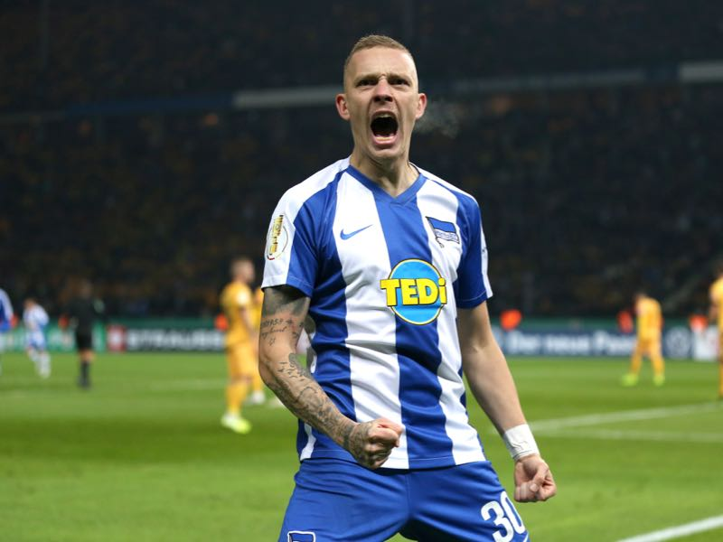 Marius Wolf of Hertha BSC celebrates after Dodi Lukebakio (not in frame) scores his side's first goal during the DFB Cup second round match between Hertha BSC and Dynamo Dresden at Olympiastadion on October 30, 2019 in Berlin, Germany. (Photo by Maja Hitij/Bongarts/Getty Images)