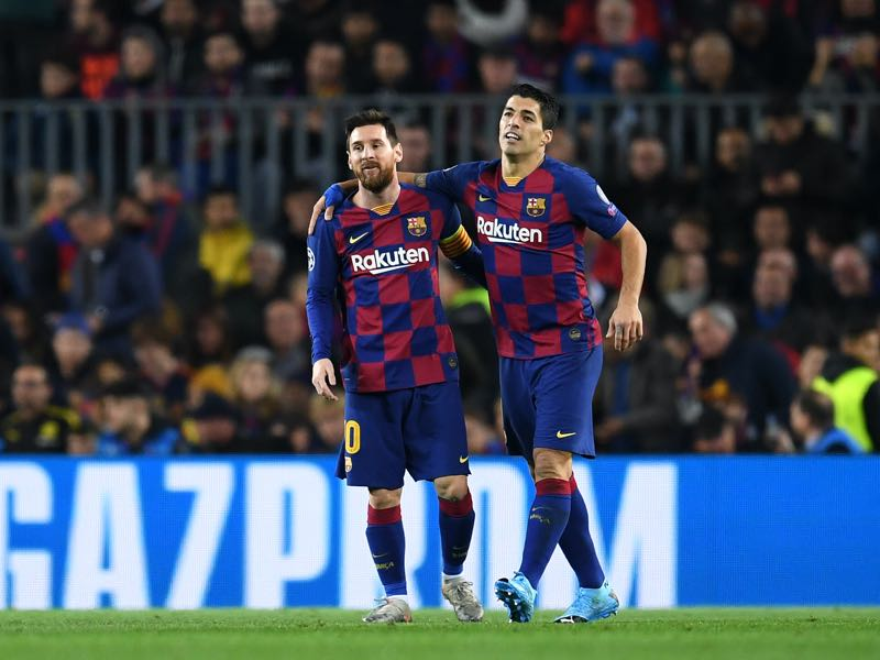 Barcelona v Dortmund - Luis Suarez of FC Barcelona celebrates with teammate Lionel Messi after scoring his team's first goal during the UEFA Champions League group F match between FC Barcelona and Borussia Dortmund at Camp Nou on November 27, 2019 in Barcelona, Spain. (Photo by David Ramos/Getty Images)