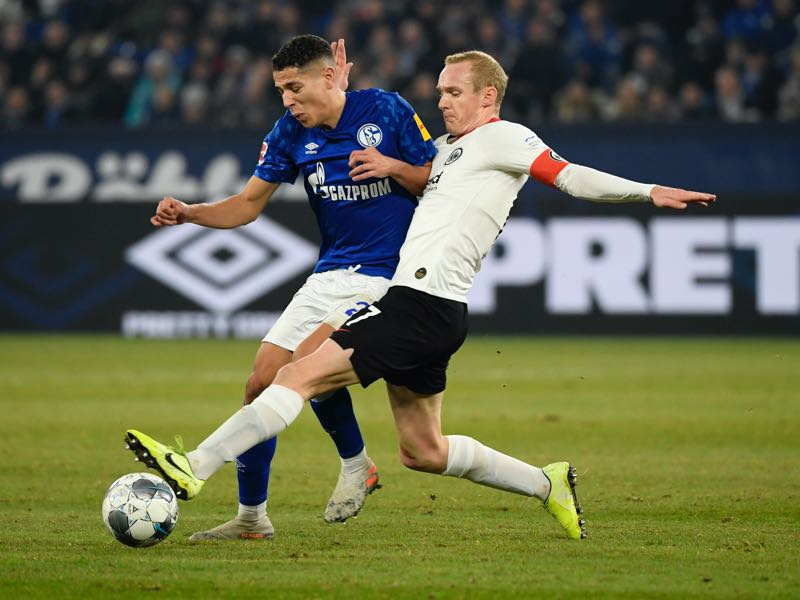Schalke v Eintracht Frankfurt - Schalke's French midfielder Amine Harit and Frankfurt's German midfielder Sebastian Rode (R) vie for the ball during the German first division Bundesliga football match Schalke 04 v Eintracht Frankfurt in Gelsenkirchen, on December 15, 2019. (Photo by INA FASSBENDER / AFP)