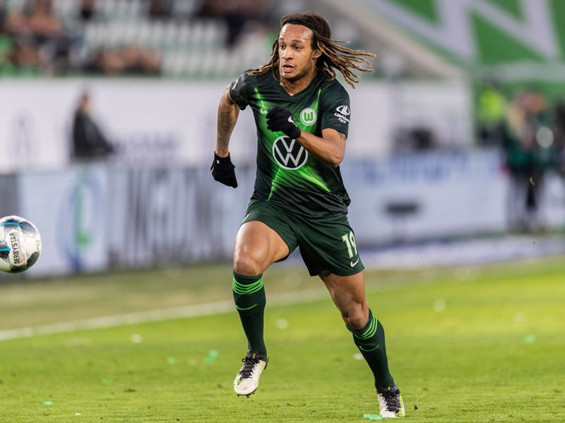Kevin Mbabu of VfL Wolfsburg runs with the ball during the Bundesliga match between VfL Wolfsburg and Borussia Moenchengladbach at Volkswagen Arena on December 15, 2019 in Wolfsburg, Germany. (Photo by Boris Streubel/Bongarts/Getty Images)