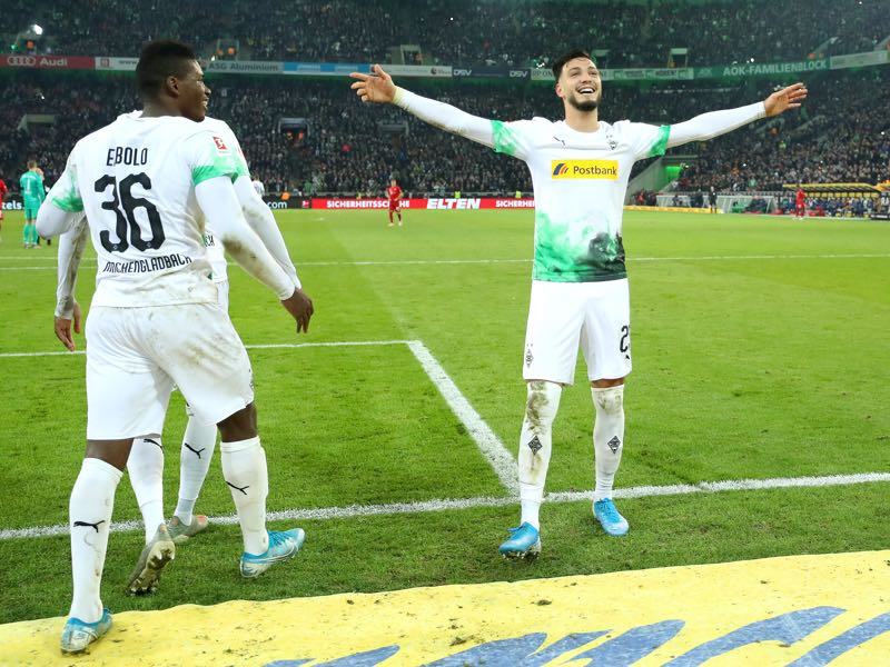 Ramy Bensebaini of Borussia Monchengladbach celebrates with Breel Embolo after scoring his team's second goal during the Bundesliga match between Borussia Moenchengladbach and FC Bayern Muenchen at Borussia-Park on December 07, 2019 in Moenchengladbach, Germany. (Photo by Lars Baron/Bongarts/Getty Images)
