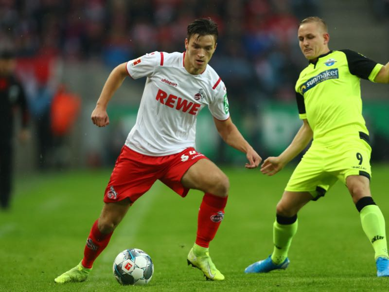 Noah Katterbach of FC Koln looks to break past Kai Pröger of SC Paderborn during the Bundesliga match between 1. FC Koeln and SC Paderborn 07 at RheinEnergieStadion on October 20, 2019 in Cologne, Germany. (Photo by Dean Mouhtaropoulos/Bongarts/Getty Images)