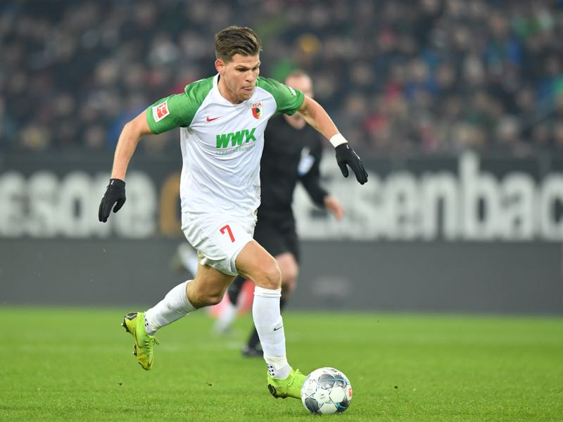 Florian Niederlechner of FC Augsburg plays the ball during the Bundesliga match between FC Augsburg and Fortuna Duesseldorf at WWK-Arena on December 17, 2019 in Augsburg, Germany. (Photo by Sebastian Widmann/Bongarts/Getty Images)