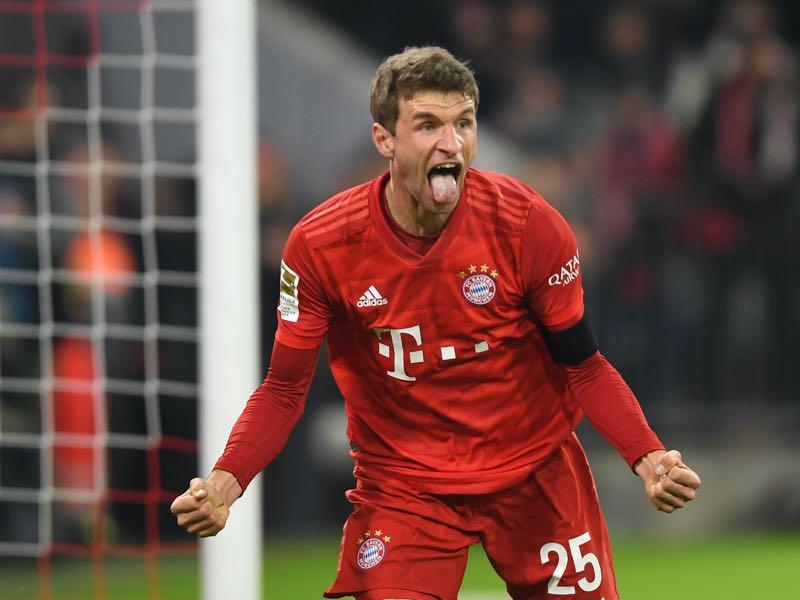 Bayern Munich's German striker Thomas Müller reacts after scoring during the German first division Bundesliga football match Bayern Munich v Schalke 04 in Munich on January 25, 2020. (Photo by Christof STACHE / AFP)