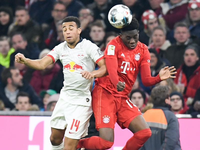 Bayern Munich v Leipzig - Bayern Munich's Canadian midfielder Alphonso Davies (R) and Leipzig's US midfielder Tyler Adams vie for the ball during the German first division Bundesliga football match FC Bayern Munich v RB Leipzig in Munich, southern Germany, on February 9, 2020. (Photo by THOMAS KIENZLE / AFP)