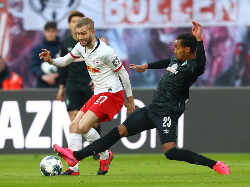RB Leipzig v Werder - Konrad Laimer of RB Leipzig is challenged by Theodor Gebre Selassie of SV Werder Bremen during the Bundesliga match between RB Leipzig and SV Werder Bremen at Red Bull Arena on February 15, 2020 in Leipzig, Germany. (Photo by Martin Rose/Bongarts/Getty Images)